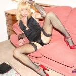 Blonde in black lingerie jerking off