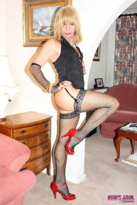Blonde in black lingerie jerking off